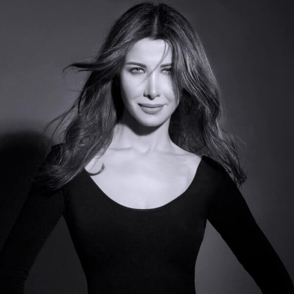 3am Bet3alla2 Feek - Nancy Ajram